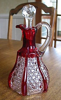 5200093524_BUTTON PANEL WITH BARS RUBY STAINED CRUET worthpoint.jpg