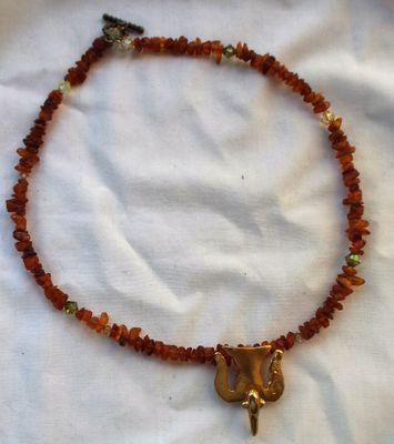 Rough amber nugget/chip beads with an Alva signed pendant.  I performed the marriage